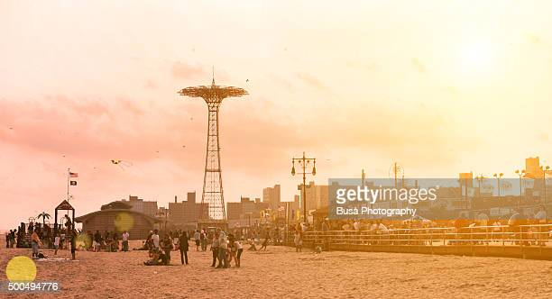 sunset at coney island beach, new york city - coney island stock pictures, royalty-free photos & images