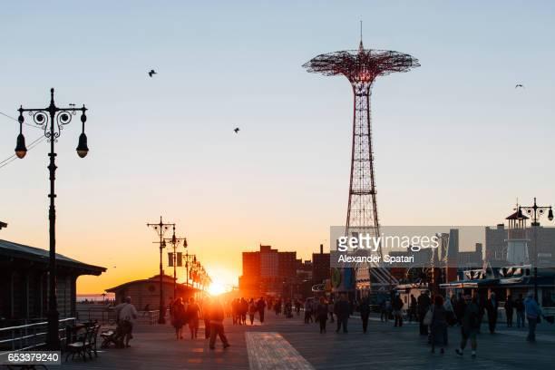Sunset at Coney Island Boardwalk, Brooklyn, New York City, NY, USA