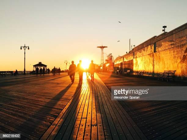 Sunset at Coney Island boardwalk, Brooklyn, New York City, USA