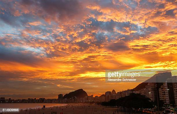 Sunset at Copacabana beach as seen from the arena of the FIVB Rio Grand Slam during day four of the FIVB Beach Volleyball Rio Grand Slam on March 11...