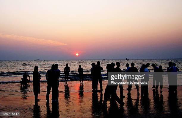 sunset at coxs bazaar - coxs bazaar stock photos and pictures