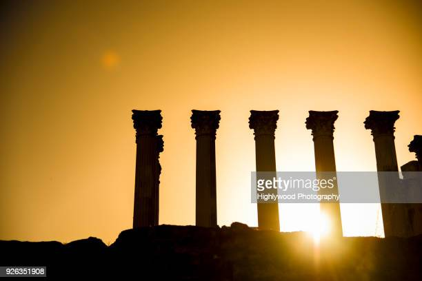 sunset at córdoba roman temple - highlywood stock pictures, royalty-free photos & images