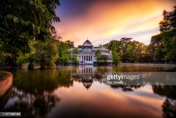 sunset at crystal palace, parque del buen retiro park. madrid, spain - madrid stock pictures, royalty-free photos & images