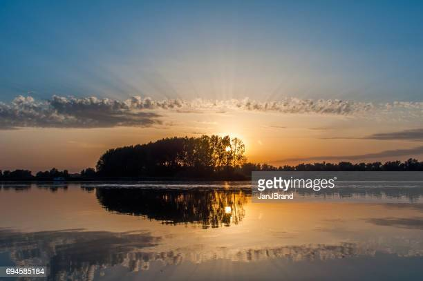 sunset at de biesbosch national park - national park stock pictures, royalty-free photos & images
