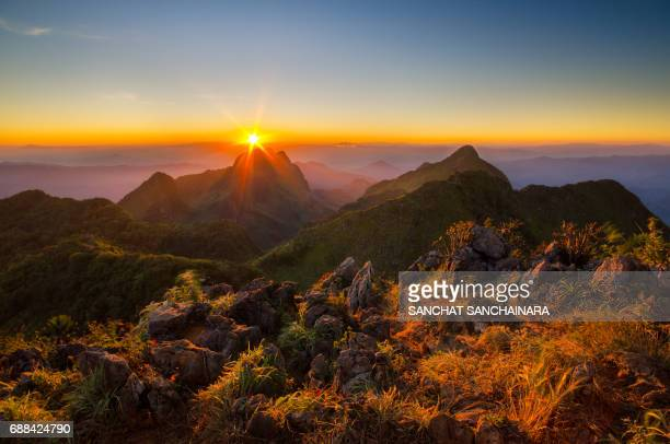sunset at doi luang chiang dao - mountain ridge stock pictures, royalty-free photos & images