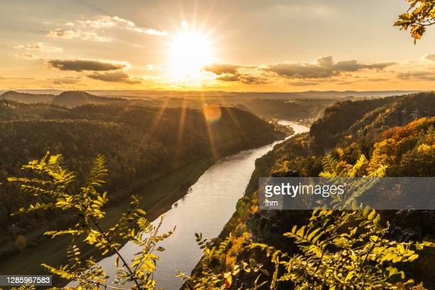 sunset at elbe river in the elbe sandstone mountains (german: elbsandsteingebirge), saxony/ germany - saxony stock pictures, royalty-free photos & images
