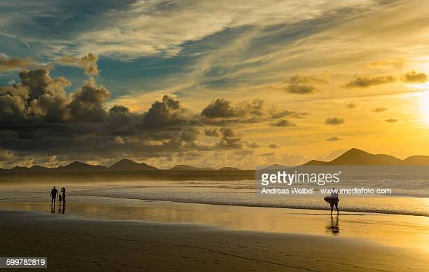 sunset at famara beach - lanzarote stock pictures, royalty-free photos & images