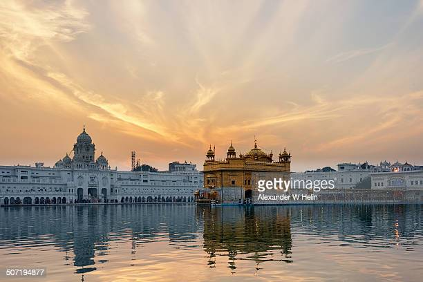 sunset at goldne temple - golden temple india stock photos and pictures