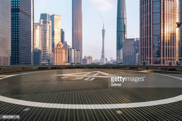 sunset at guangzhou - helipad stock photos and pictures