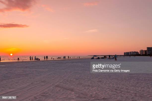 Sunset at Gulf of Mexico beach. Summer sky at Marco Island beach in Southern Florida, USA