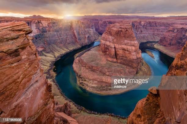 sunset at horseshoe bend, near page, arizona - natural landmark stock pictures, royalty-free photos & images