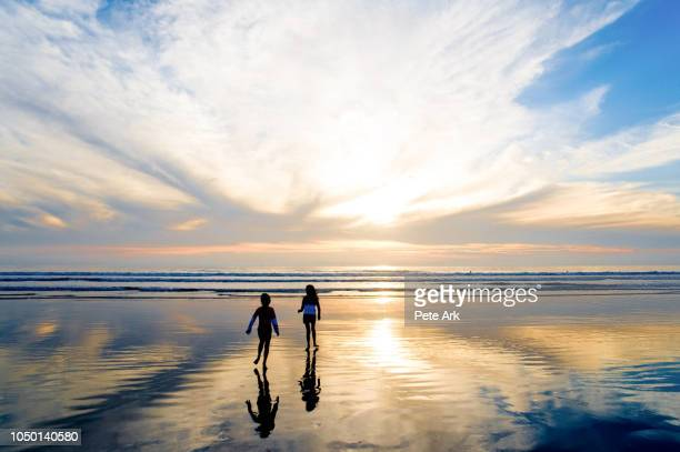 sunset at huntington beach - reflection pool stock pictures, royalty-free photos & images