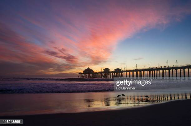 sunset at huntington beach pier - huntington beach stock pictures, royalty-free photos & images