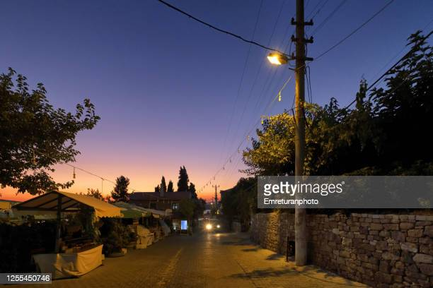 sunset at ildir village main road on a summer night. - emreturanphoto fotografías e imágenes de stock