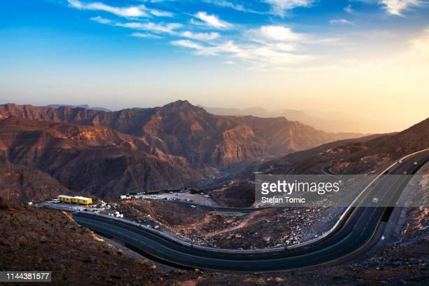 sunset at jabal jais mountain in the uae - ras al khaimah stock pictures, royalty-free photos & images