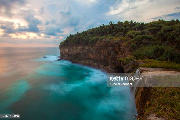 sunset at karang bolong beach pacitan, east java - indonesia - east java province stock photos and pictures
