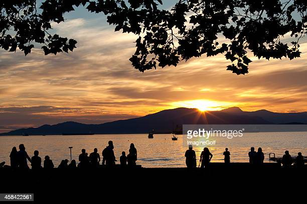 sunset at kitslano beach in vancouver - english bay stock photos and pictures
