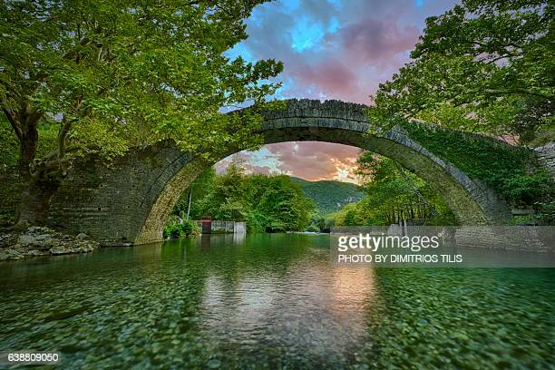 sunset at klidhonia's stone bridge - epirus greece stock pictures, royalty-free photos & images