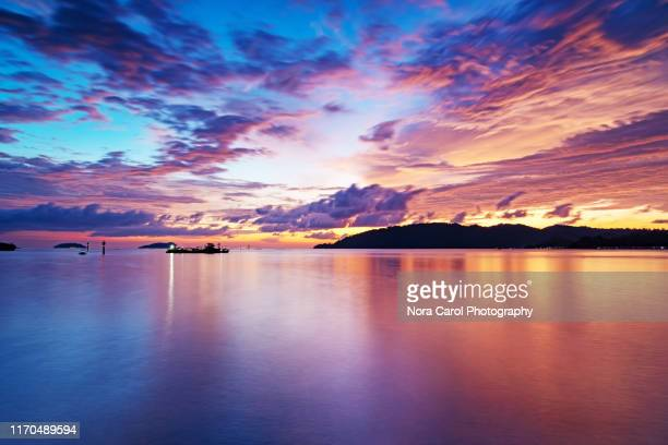 sunset at kota kinabalu city - kota kinabalu stock pictures, royalty-free photos & images