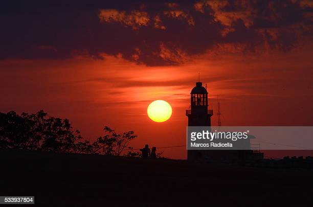 sunset at la cabaña fortress, havana, cuba - radicella stock photos and pictures