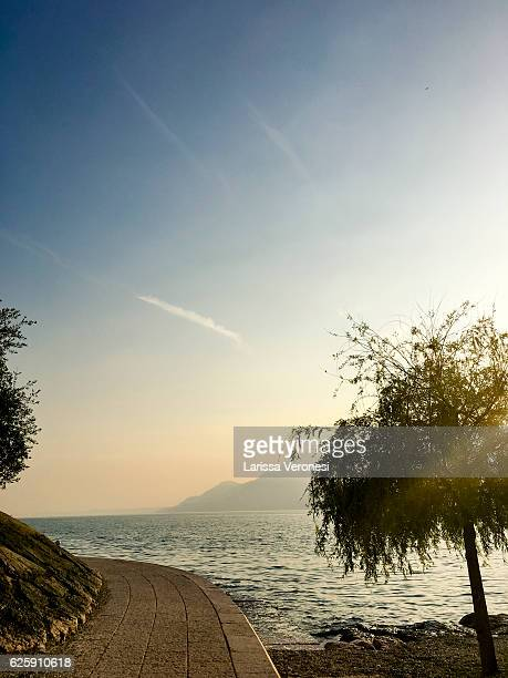 sunset at lake garda, brenzone, italy - larissa veronesi stock pictures, royalty-free photos & images