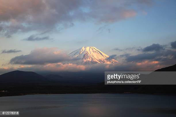 Sunset at Lake Motosu and Mount Fuji seen through cloud