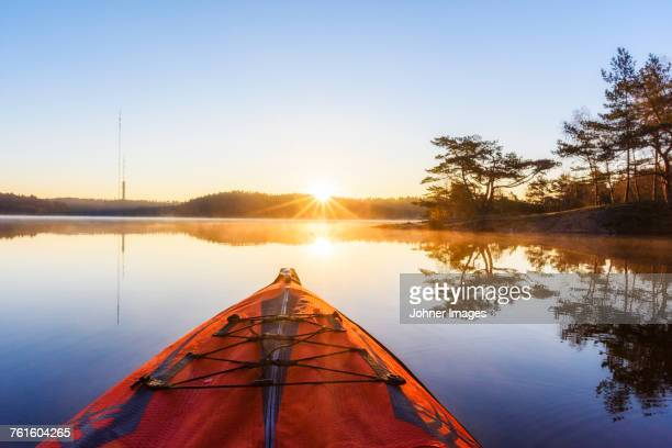 sunset at lake - canoe stock pictures, royalty-free photos & images