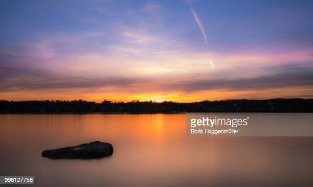 sunset at lake starnberg, kempfenhausen - boris stock photos and pictures