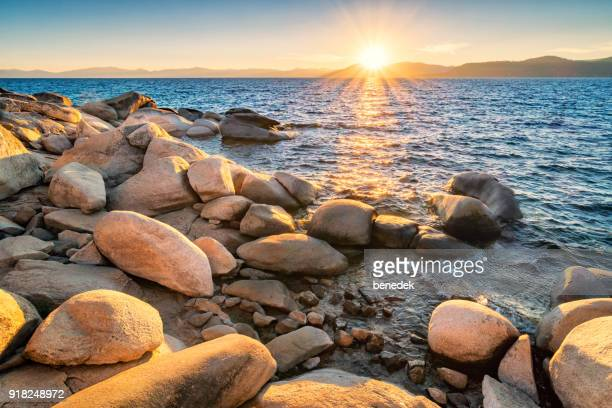 sunset at lake tahoe usa - water's edge stock pictures, royalty-free photos & images