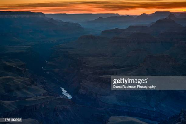 sunset at lipan point on the south rim of grand canyon national park, arizona - colorado river stock pictures, royalty-free photos & images