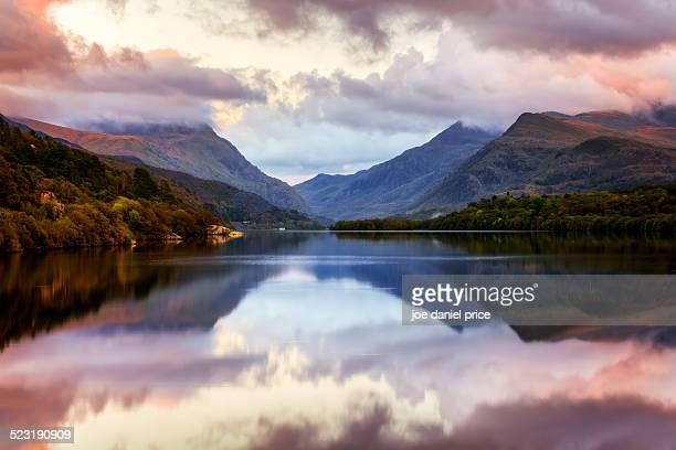 sunset at llyn padarn, llanberis - gwynedd stock photos and pictures