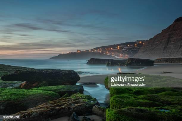 sunset at magoito beach - faro city portugal fotografías e imágenes de stock