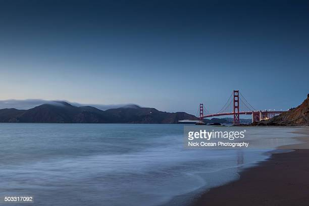 sunset at marshal beach, golden gate bridge, san francisco, ca - stoking stock pictures, royalty-free photos & images