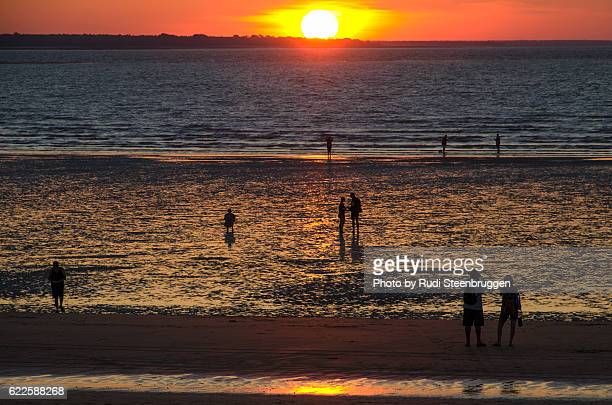 sunset at mindil beach - sunset beach stock photos and pictures
