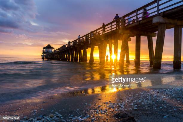 sunset at naples pier - naples florida stock pictures, royalty-free photos & images