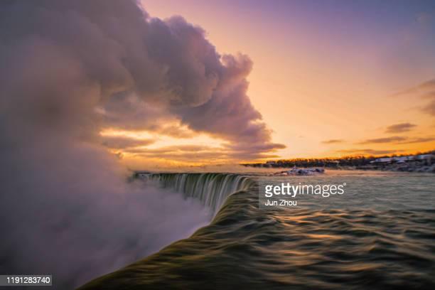 sunset at niagara fall - niagara falls photos stock pictures, royalty-free photos & images