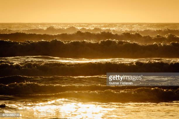sunset at ocean beach - gunnar helliesen stock pictures, royalty-free photos & images