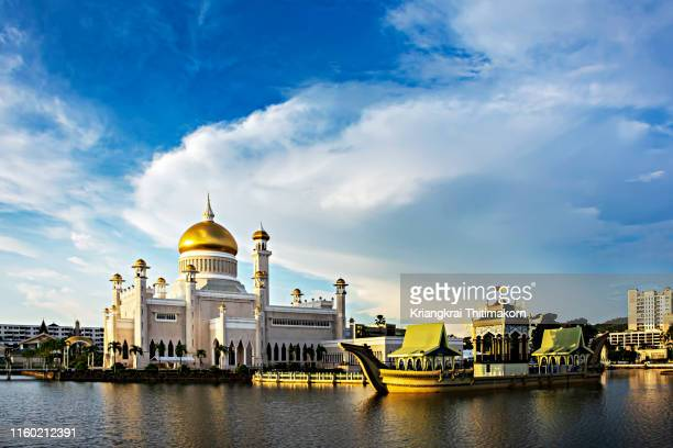 sunset at omar ali saifuddein mosque. - bandar seri begawan stock photos and pictures