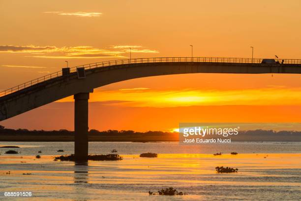 sunset at paraguay river - silhueta stock photos and pictures
