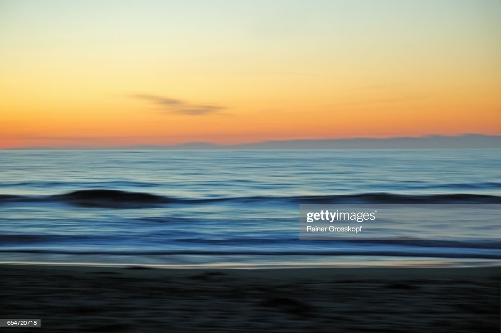 Sunset at Pcific ocean beach (blurred) : Stock-Foto