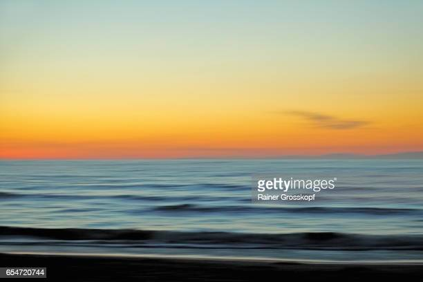 sunset at pcific ocean beach (blurred) - rainer grosskopf stock pictures, royalty-free photos & images