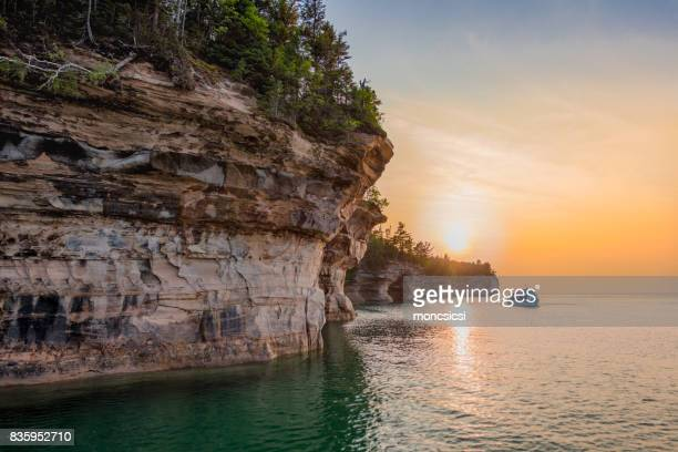 sunset at pictured rocks national lakeshore - pictured rocks national lakeshore stock pictures, royalty-free photos & images