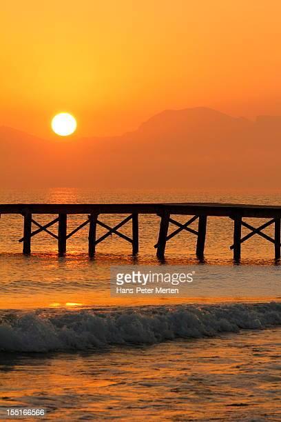 sunset at playa de muro, mallorca, spain - muro stock photos and pictures