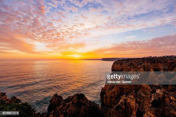 sunset at ponta da piedade, algarve, portugal - lagos portugal stock photos and pictures