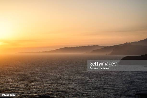 sunset at pt. bonita - gunnar helliesen stock pictures, royalty-free photos & images