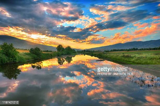 sunset at  river  neochoritis - dimitrios tilis stock pictures, royalty-free photos & images