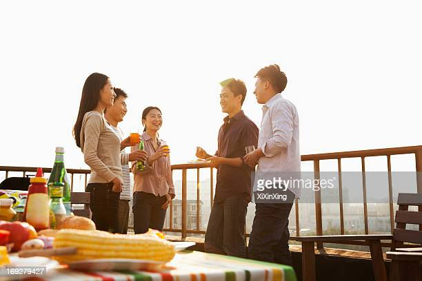 sunset at rooftop barbecue - asian drink stock photos and pictures