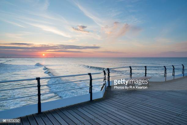 sunset at saltburn pier, north yorkshire, england - saltburn stock photos and pictures