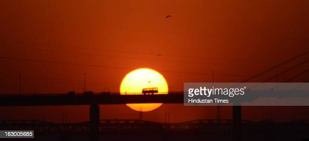 Sunset at Sangam in the Kumbh Mela area on March 3 2013 in Allahabad India The mega religious fair held once in 12 years last official bathing on...