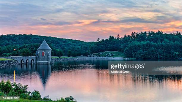 sunset at saville dam. barkhamsted, connecticut. castle turret. - connecticut stock pictures, royalty-free photos & images